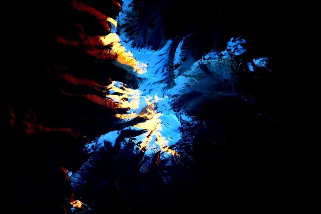 Andes Mountains with sun shining from Space July 30 2015