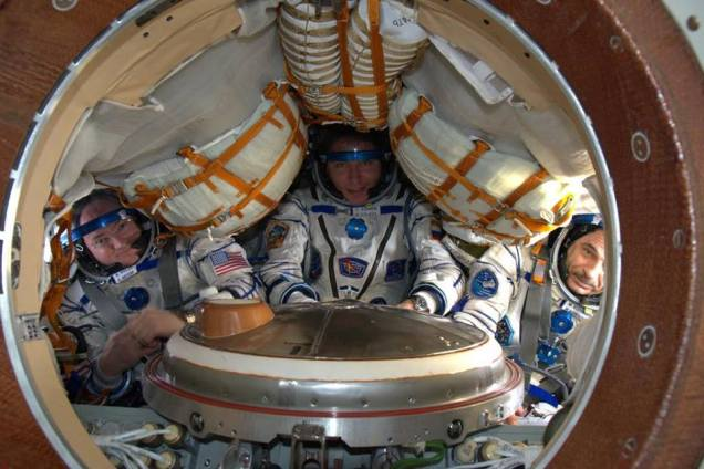 Astronaut Scott Kelly, Russian cosmonauts Mikhail Kornienko and Sergey Volkov Sokol suit fit check on February 23, 2016.